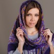 Portrait of a beautiful young woman with a scarf on her head — Stock Photo #49885357