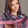 Portrait of a beautiful young woman with a scarf on her head — Stock Photo #49885363