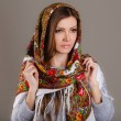 Portrait of a beautiful young woman with a scarf on her head — Stock Photo #49885387