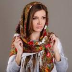 Retrato de una bella mujer joven con un pañuelo en la cabeza — Foto de Stock   #49885387