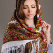 Portrait of a beautiful young woman with a scarf on her head — Stock Photo #49885407
