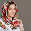 Portrait of a beautiful young woman with a scarf on her head — Stock Photo #49885413