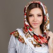 Portrait of a beautiful young woman with a scarf on her head — Stock Photo #49885415
