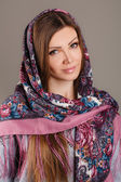 Portrait of a beautiful young woman with a scarf on her head — Stock Photo