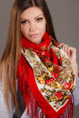 Portrait of a beautiful young woman with a scarf. — Stock Photo