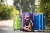 Beautiful young lady travelling with a suitcase — Foto de Stock