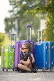 Beautiful young lady travelling with a suitcase — ストック写真