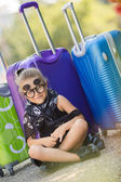 Beautiful young lady travelling with a suitcase — Stock fotografie