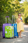 Beautiful young lady travelling with a suitcase — Stock Photo