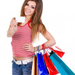 Young woman holding shopping bags and card — Stock Photo #8986868