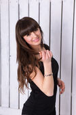 Brunette smiling girl over white background — Стоковое фото