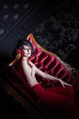 Stylish shot of girl in the sofa — Stock Photo