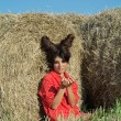Girl with devil image in countryside — Stock Photo