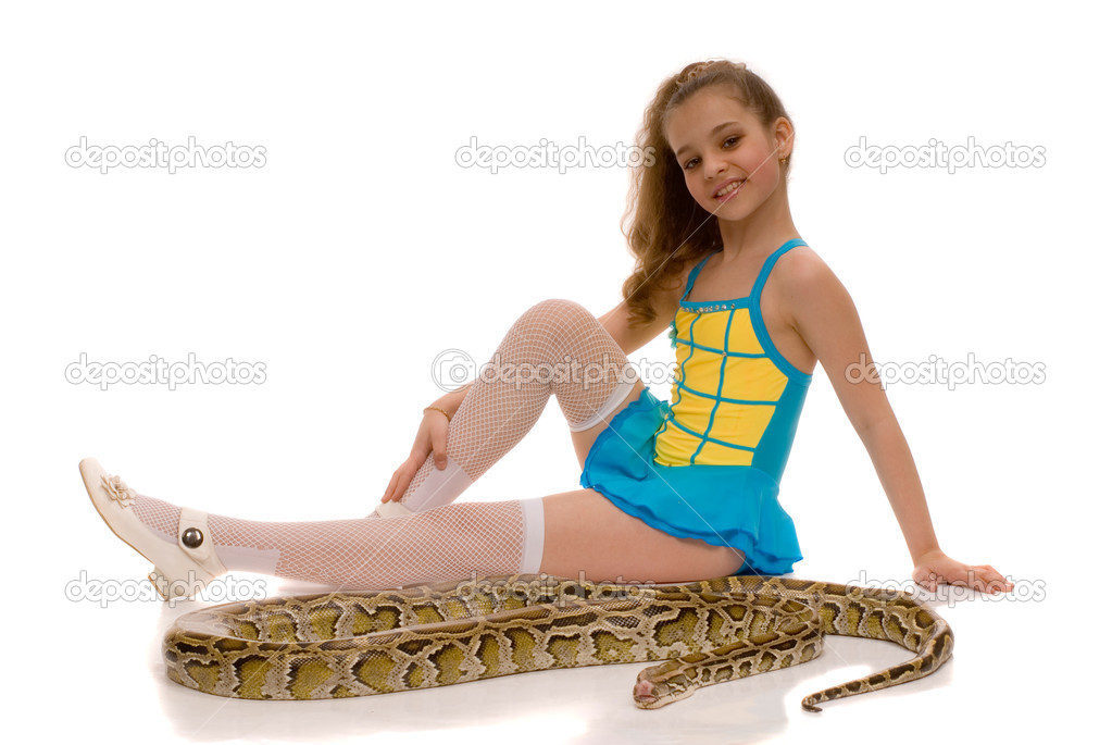 Stock image of 'Young girl with royal python snake lying by her feet. www.colourbox.com.
