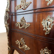 Brown wooden dresser. - Stock Photo
