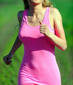 Young woman jogging in the park. — Stock Photo
