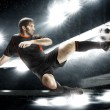 Football player striking the ball — Stock Photo #47840893