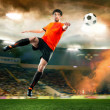Football player striking the ball at the stadium — Stock Photo #47889201
