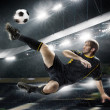 Football player striking the ball — Stock Photo #47934097