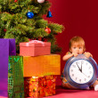 Baby with clock — Stock Photo