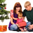 Baby near christmas tree — Stockfoto