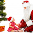 Stock Photo: Baby and santclaus