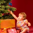 Baby with christmas toy — Stock Photo
