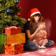 Stock Photo: Blowing snow flakes near christmas tree