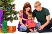 Baby near christmas tree — Stock Photo