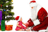 Baby and santa claus — Stock Photo