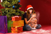 Blowing snow flakes near christmas tree — Stock Photo