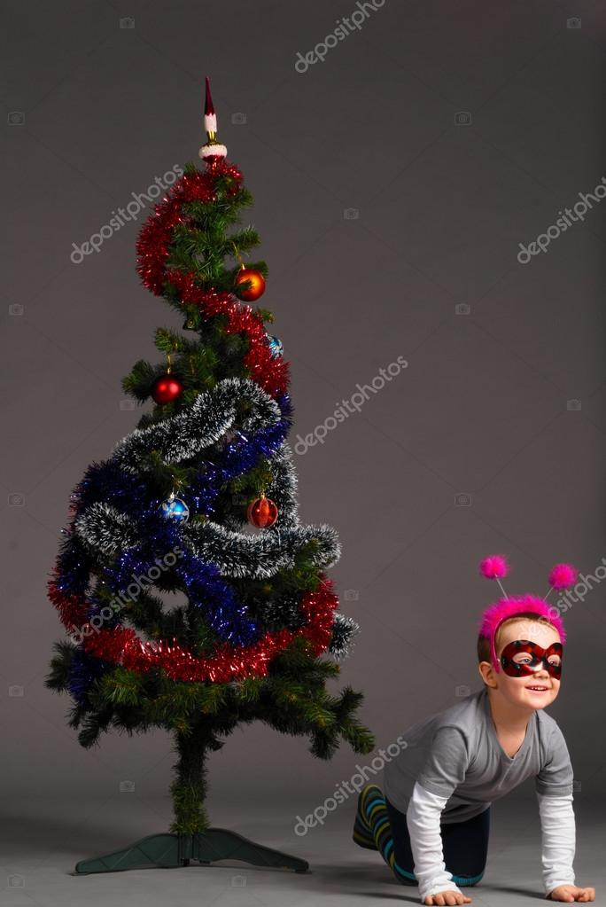 Boy is playing near christmas tree  Stock Photo #13861344