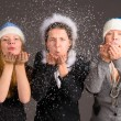Stock Photo: Blowing out snow flakes