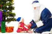 Baby and santa claus — Stock Photo