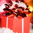 Red gift box on snow — Stock Photo