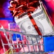Shopping cart with money — Stock Photo #14888993
