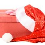 Gift box under santa hat — Stock Photo #15727521