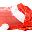 Gift box under santa hat — Stock Photo