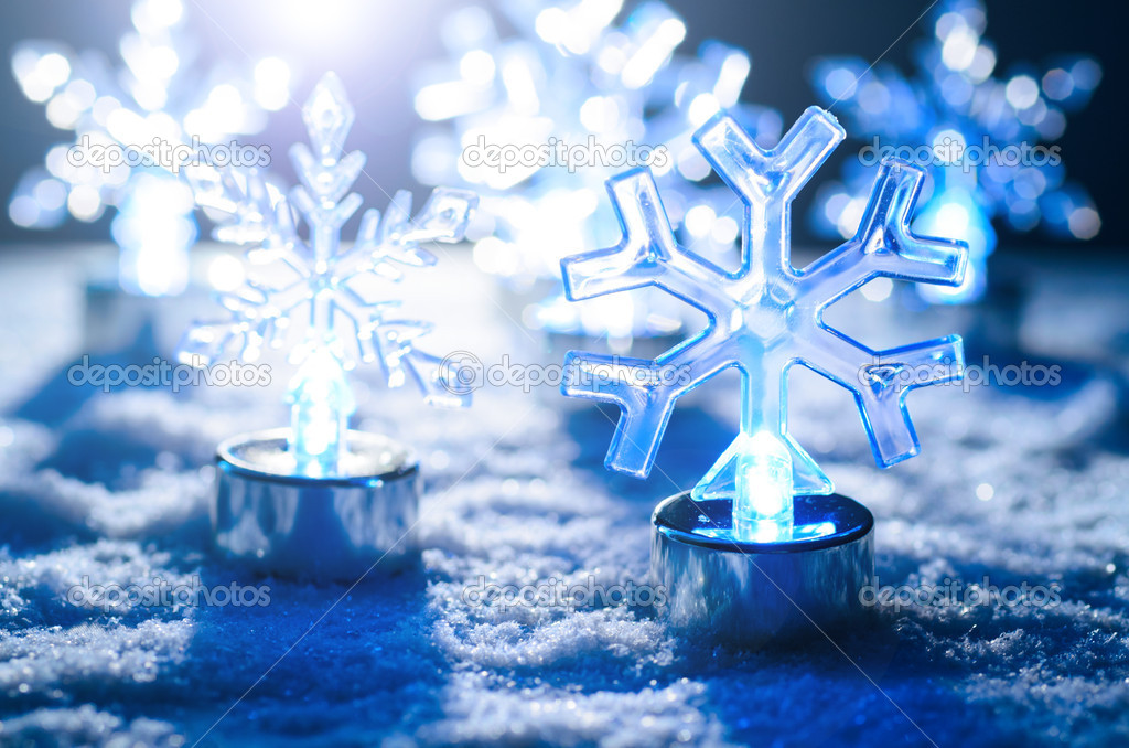 Transparent glowing snowflakes on snow, blue toned — Foto Stock #15727363