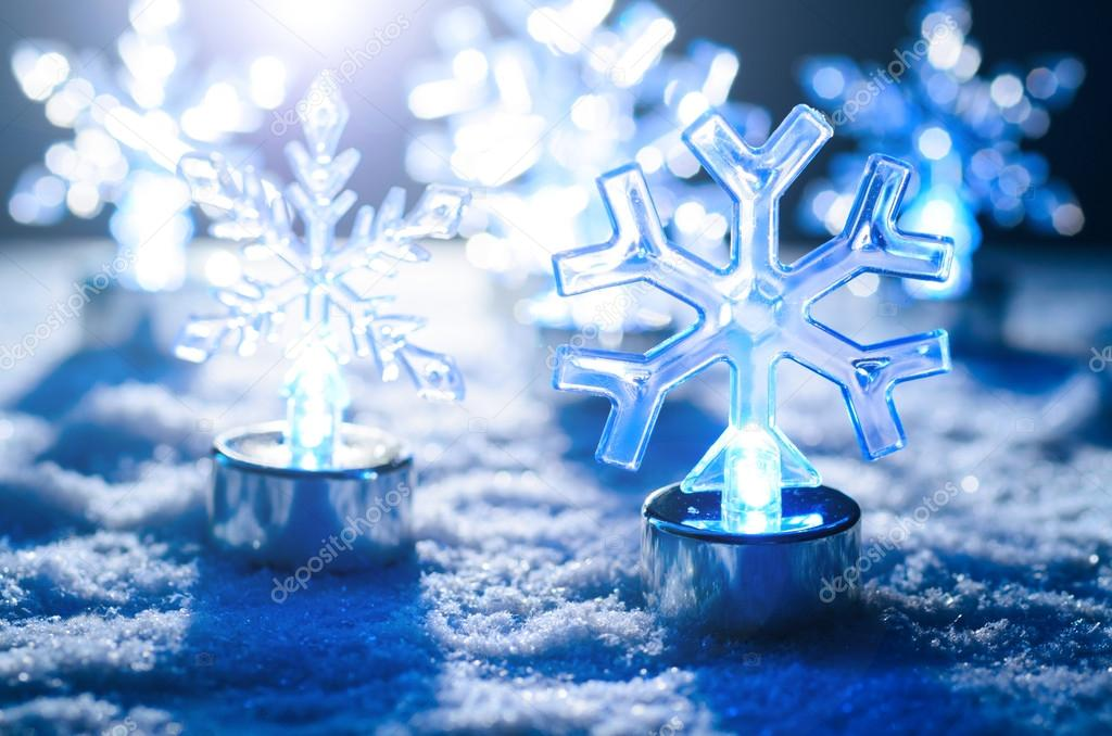 Transparent glowing snowflakes on snow, blue toned — Stok fotoğraf #15727363