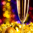 Champagne with christmas toys — Stock Photo