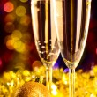 Champagne with christmas toys — Stock Photo #16332735