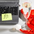 Laptop with santa hat and wine — Stock Photo