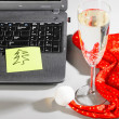 Stock Photo: Laptop with santa hat and wine