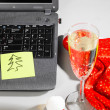 Laptop with santa hat and wine — Stock Photo #16889715