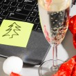 Royalty-Free Stock Photo: Laptop with santa hat and wine