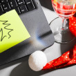 Laptop with santa hat and wine - Stock Photo