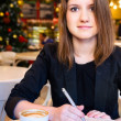 Woman in modern cafe — Stockfoto