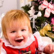 Baby near christmas tree — Stock Photo