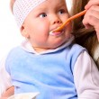 Stock Photo: Woman is feeding her baby